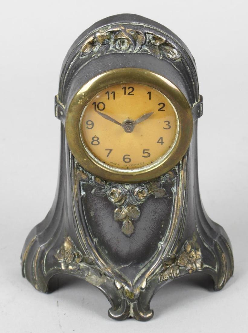 A Victorian gilt metal and porcelain panel mantel