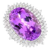 A kunzite and diamond dress ring The ovalshape