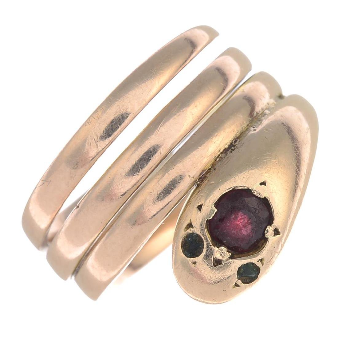 An early 20th century 12ct gold garnet snake ring.