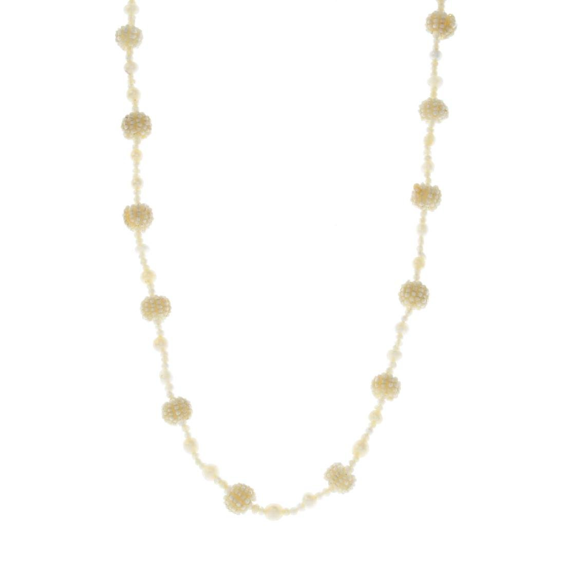 Two pearl necklaces. The first designed as a series of