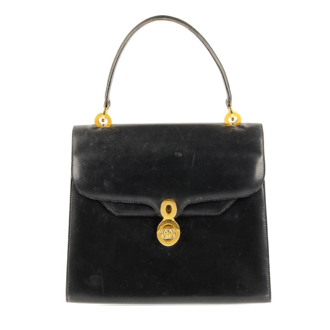 GUCCI - a vintage leather box handbag. Designed with a