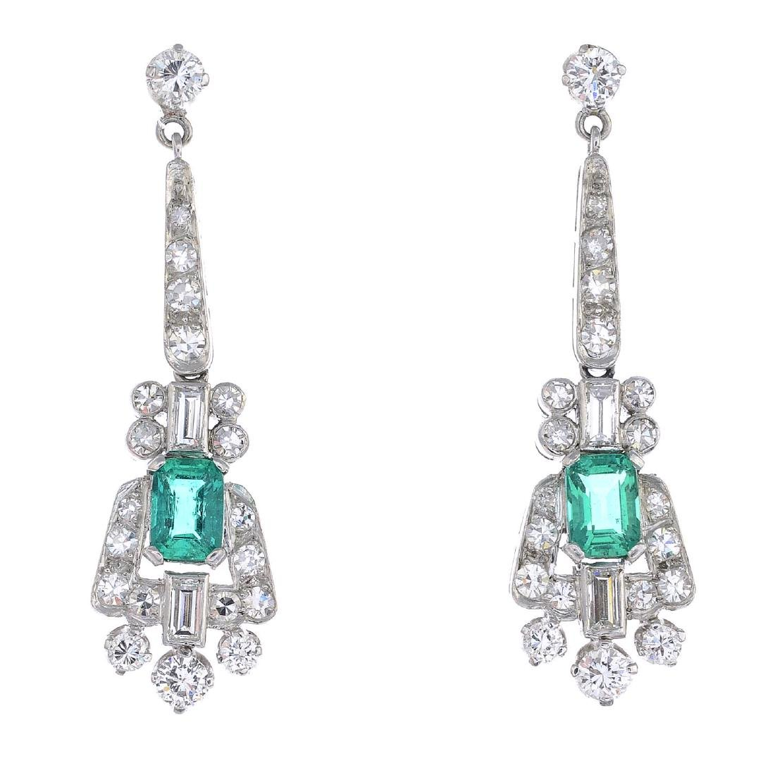A pair of Colombian emerald and diamond earrings. Each