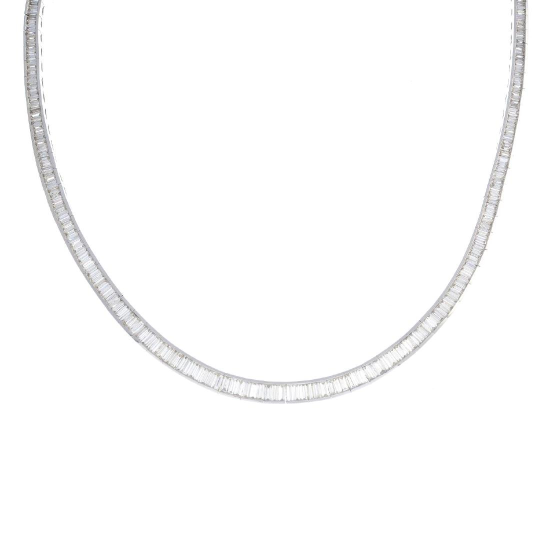 A diamond necklace. The slightly graduated baguette-cut