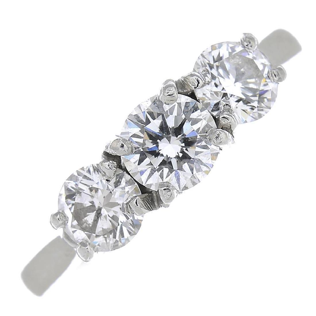 A platinum diamond three-stone ring. The brilliant-cut