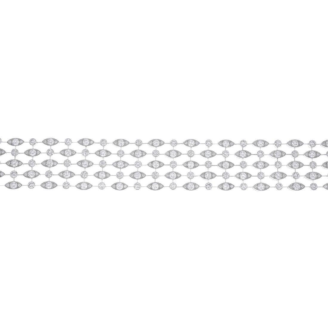 CARTIER - an 18ct gold diamond 'Naide' bracelet. The