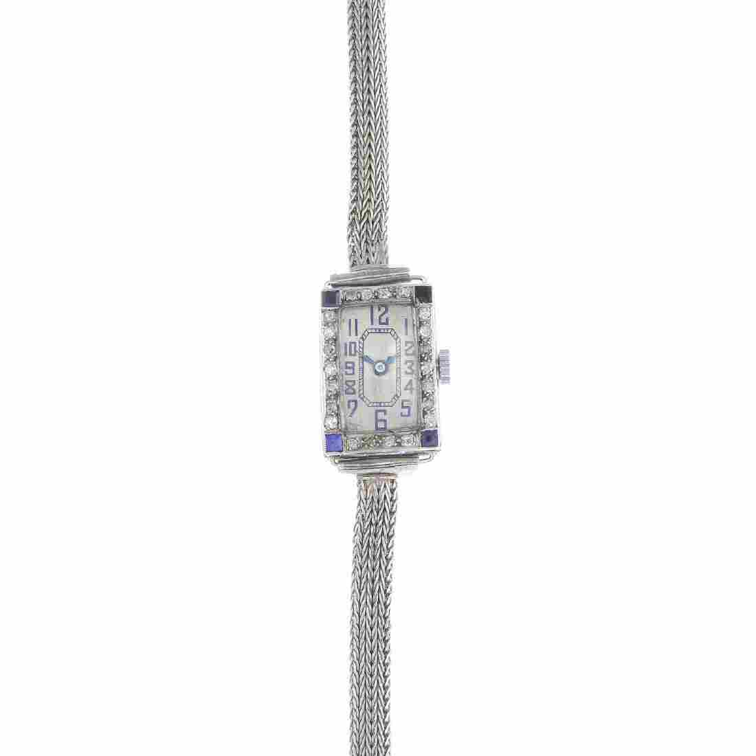 A mid 20th century diamond and sapphire cocktail watch.