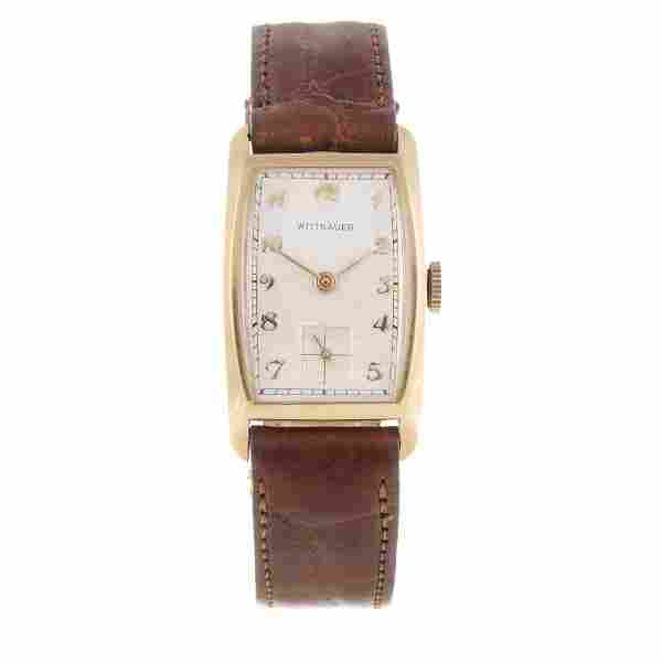 WITTNAUER - a wrist watch. Yellow metal case, stamped