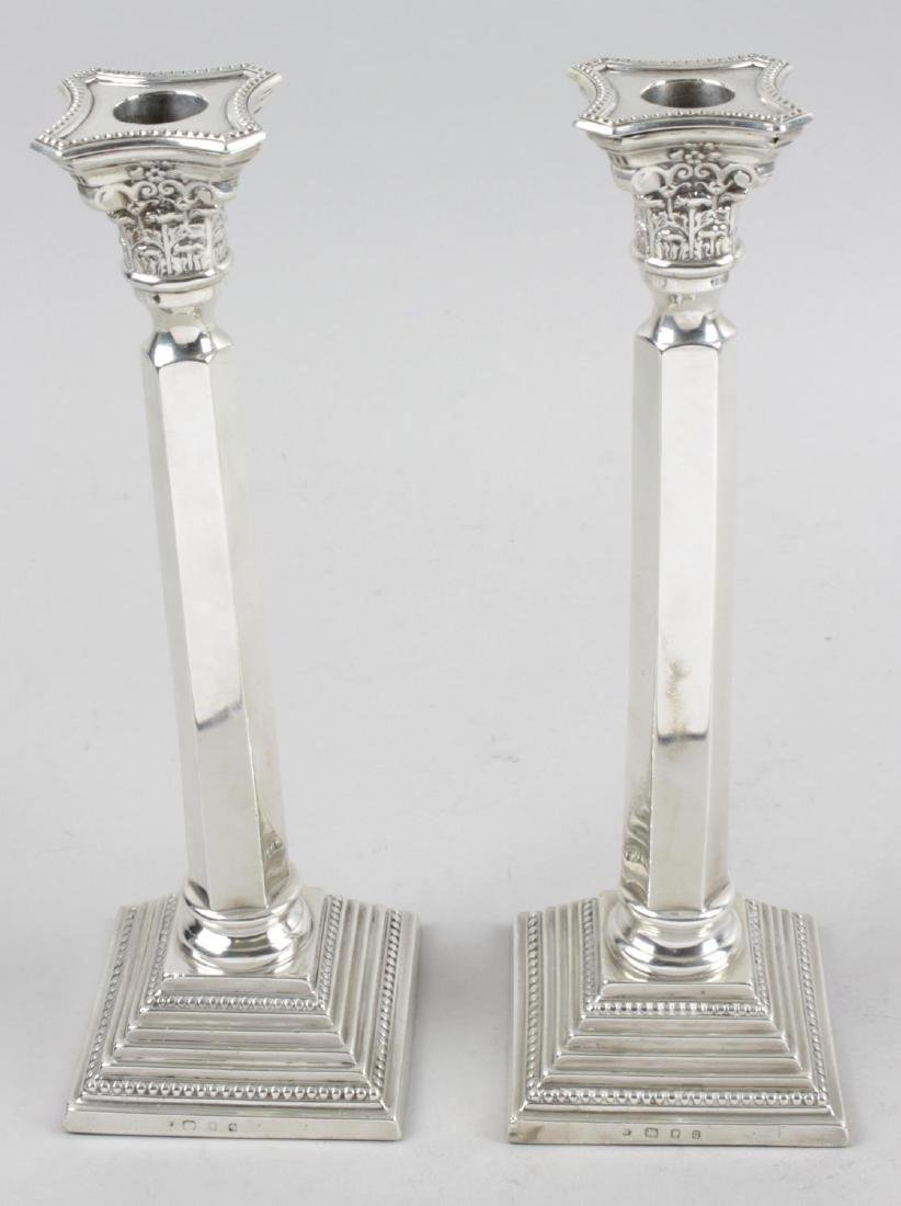 A pair of 1930's silver candlesticks, each with stepped