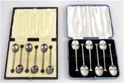 Two cased sets of six 1920s silver coffee spoons the