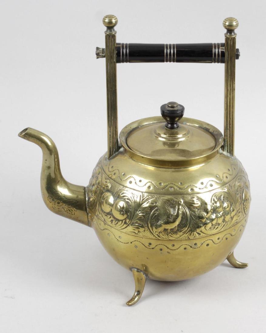 A late 19th century Aesthetic movement brass spirit