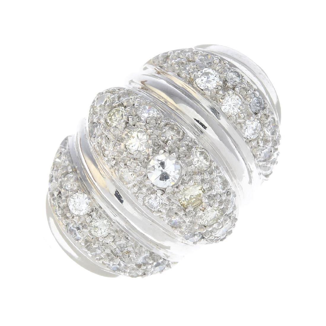 A diamond dress ring. The pave-set diamond