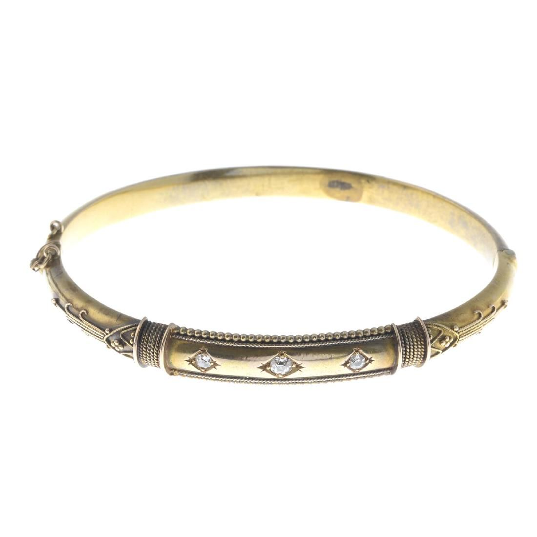 A late Victorian gold diamond hinged bangle. The