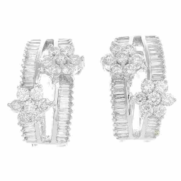 A pair of 18ct gold diamond earrings. Each designed as