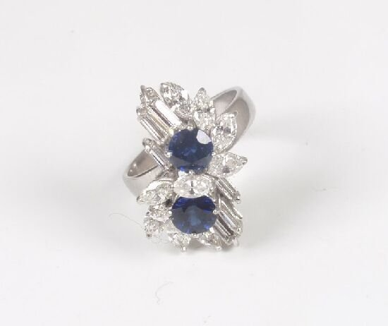 1019: A sapphire, marquise, and baguette cut