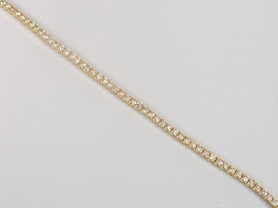 1022: 18ct gold diamond line bracelet, the ar