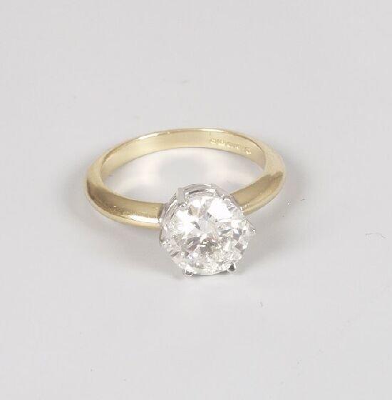 1193: 18ct gold single stone diamond ring, th