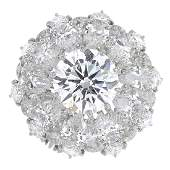 CARTIER  a platinum and 18ct gold diamond cluster