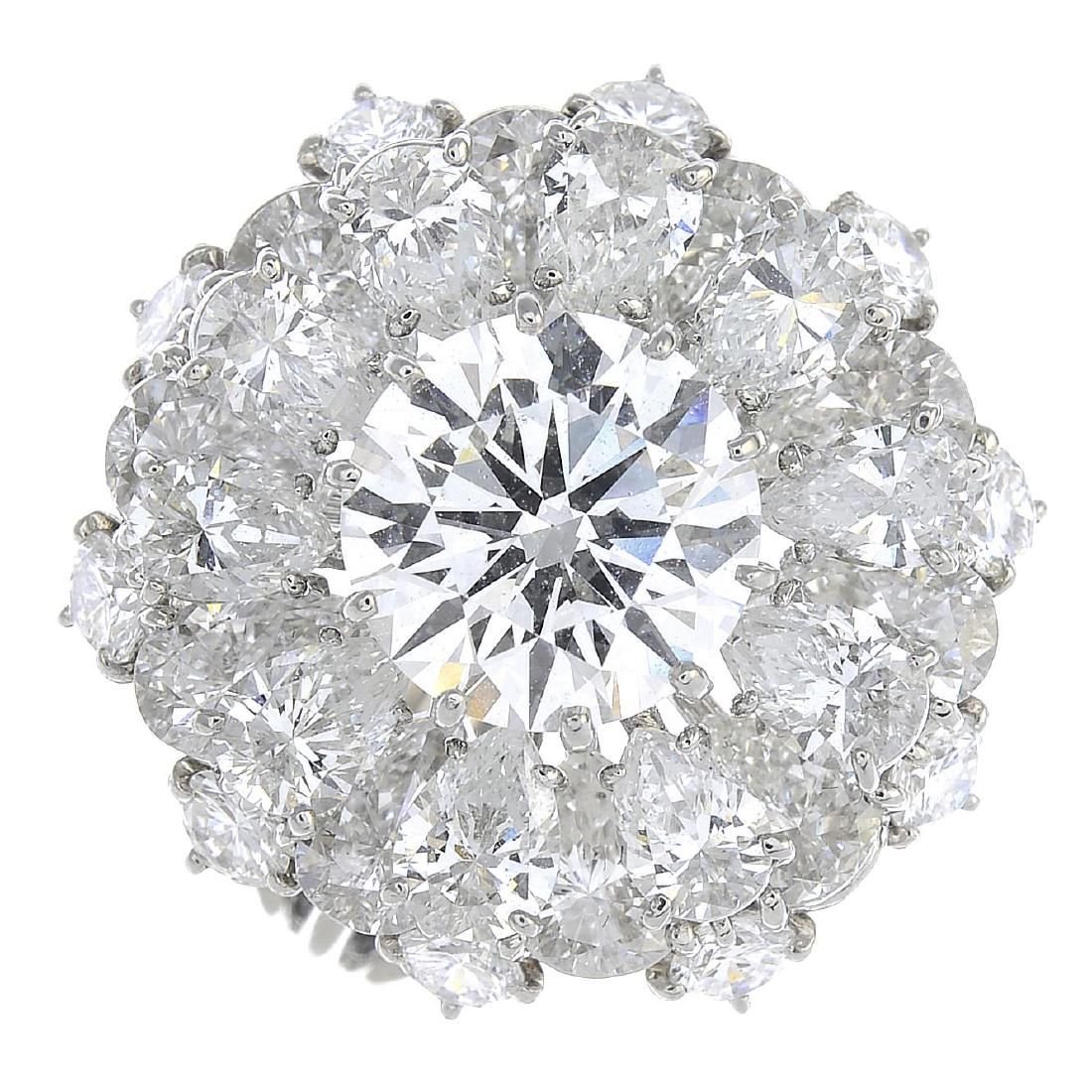 CARTIER - a platinum and 18ct gold diamond cluster