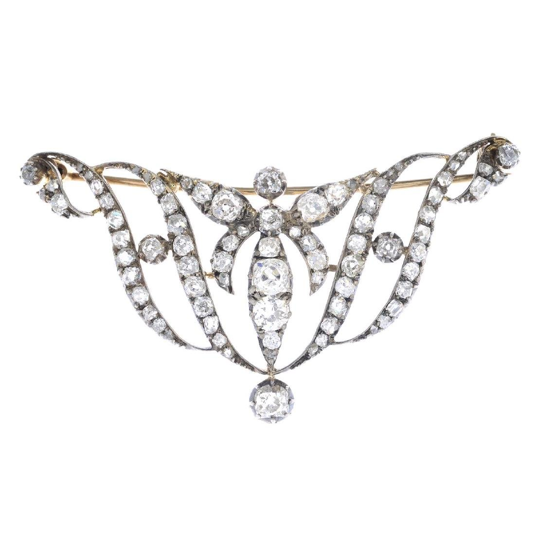 A 19th century silver and gold diamond brooch. Designed