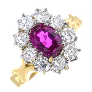 An 18ct gold Burmese ruby and diamond cluster ring. The