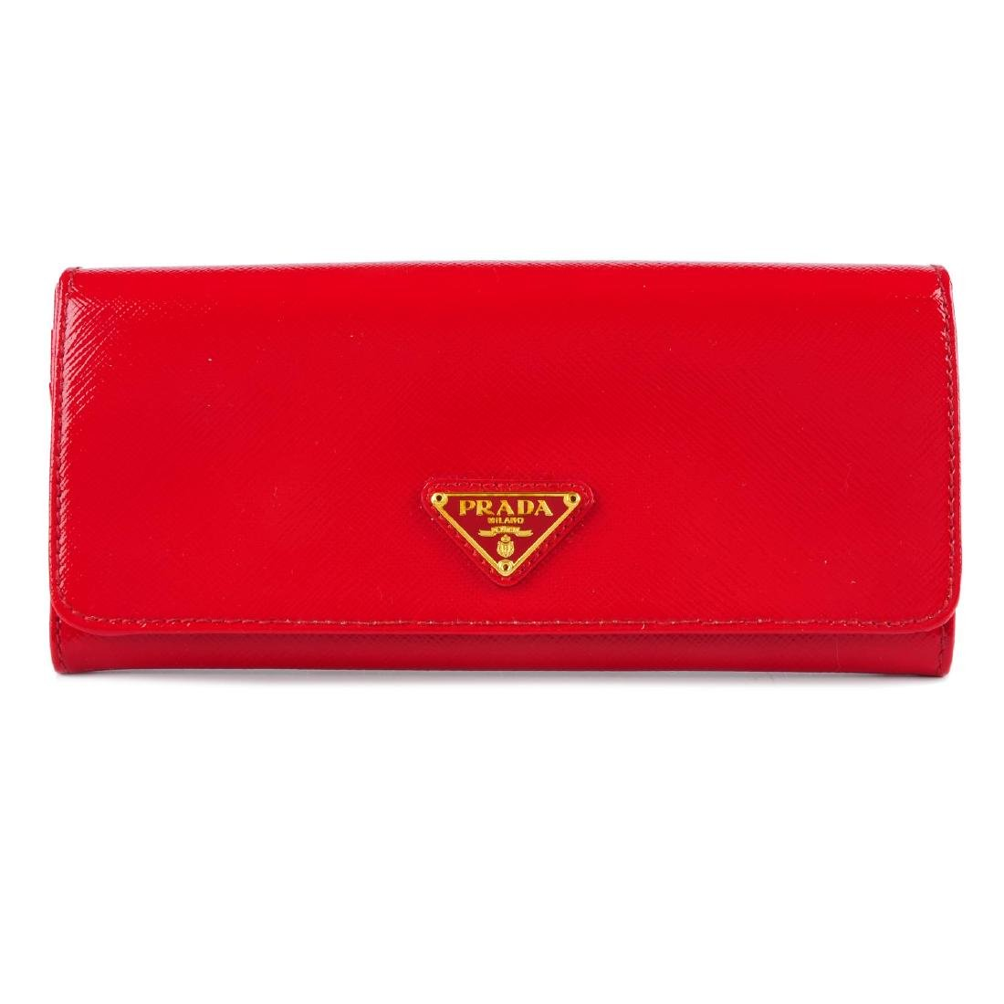 PRADA - a red Saffiano continental wallet. Designed