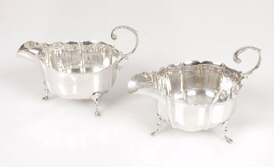 2006: Pair of silver sauce boats with fretwor