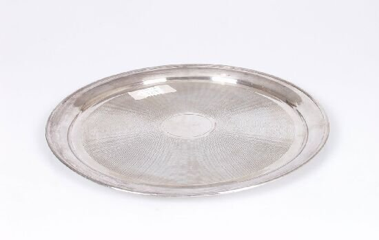 2052: A silver circular tray, with engine tur