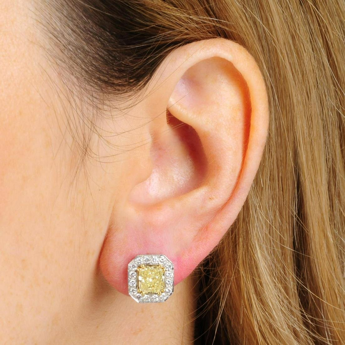 A pair of 18ct gold Fancy Yellow diamond and diamond