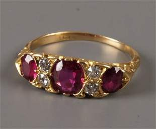 Edwardian 18ct gold ruby and diamond carved half ho