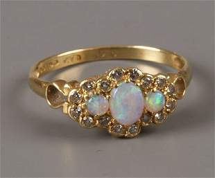 18ct gold opal and diamond cluster ring with three