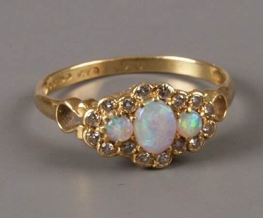 22: 18ct gold opal and diamond cluster ring with three