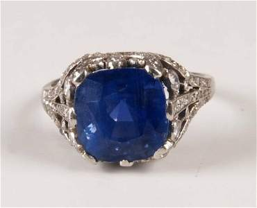 63: Large cushion cut sapphire set ring with old cut di