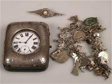 993: Silver fancy link bracelet with charms attached, a
