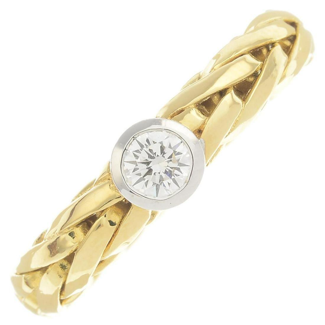 An 18ct gold diamond single-stone ring.Diamond weight