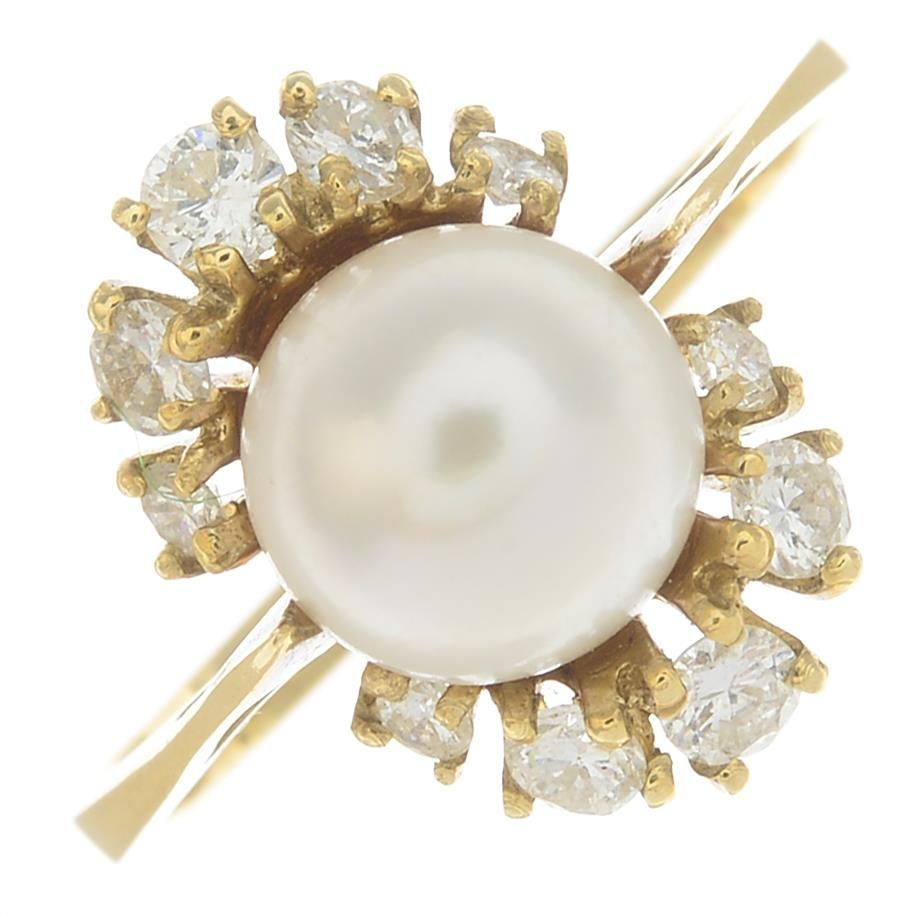 A 14ct gold cultured pearl and diamond cluster ring.