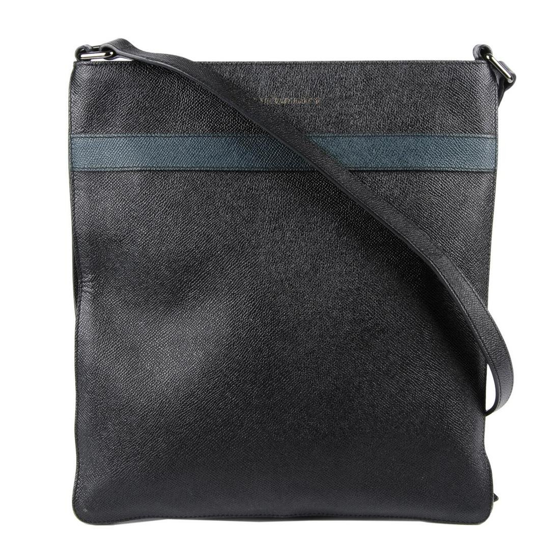 BURBERRY - a leather crossbody messenger bag. Featuring