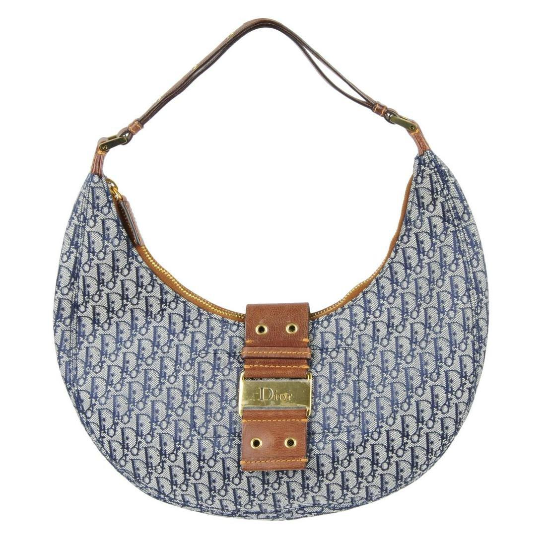 CHRISTIAN DIOR - a small hobo handbag. Designed with a