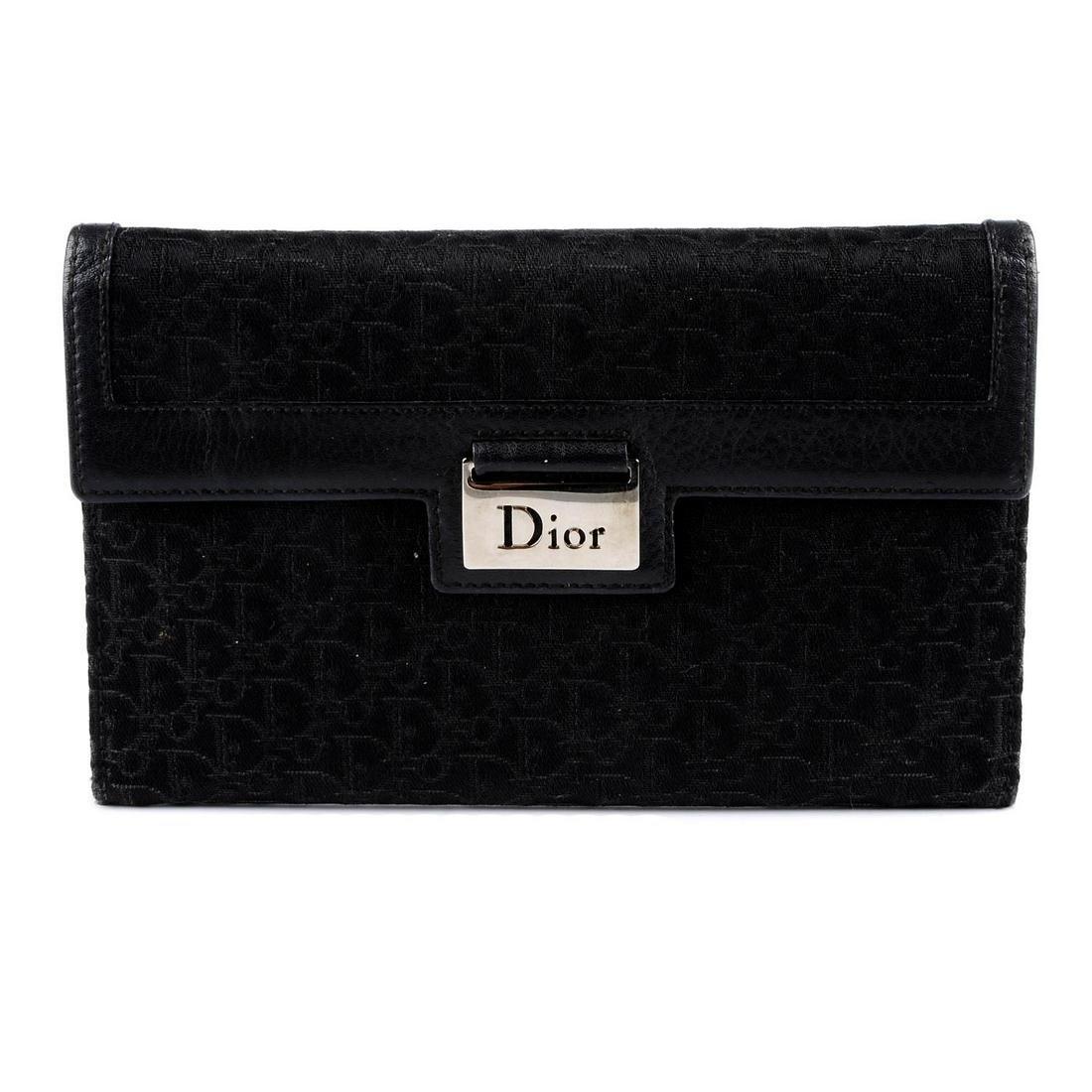 CHRISTIAN DIOR - a black wallet. Designed with maker's