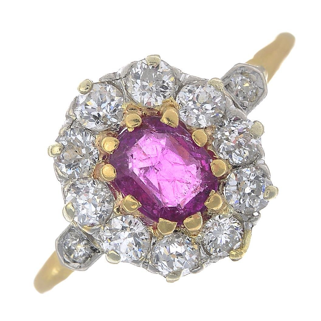 A cushion-shape ruby and old-cut diamond cluster ring.