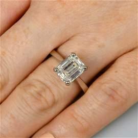 A platinum rectangular-shape diamond single-stone