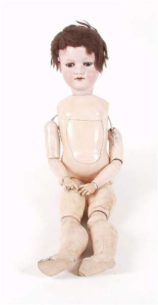 An Armand Marseille bisque headed doll,