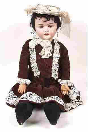 A German bisque headed doll, modelled as