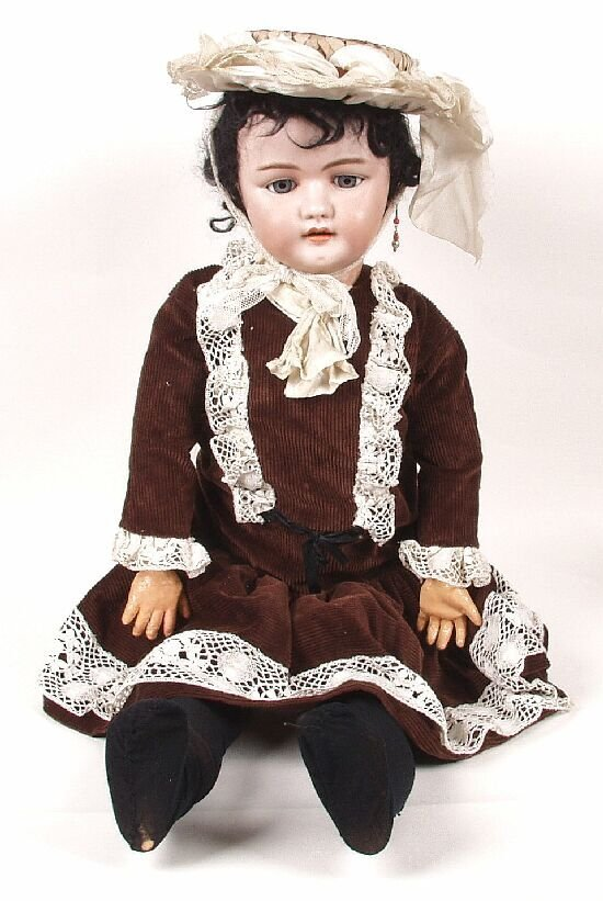 12: A German bisque headed doll,  modelled as