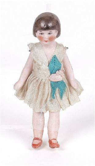 A bisque dolls house doll, modelled as a