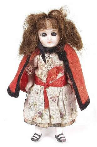 A miniature bisque doll, modelled as a yo