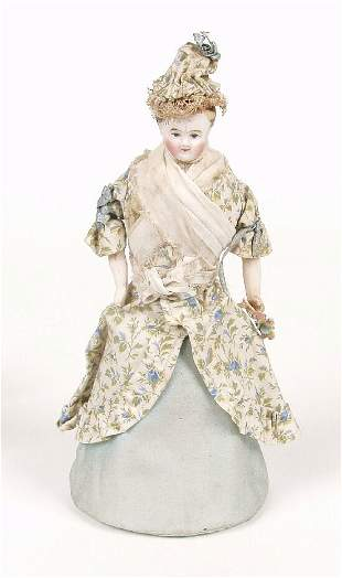 A miniature bisque shoulder plate doll,