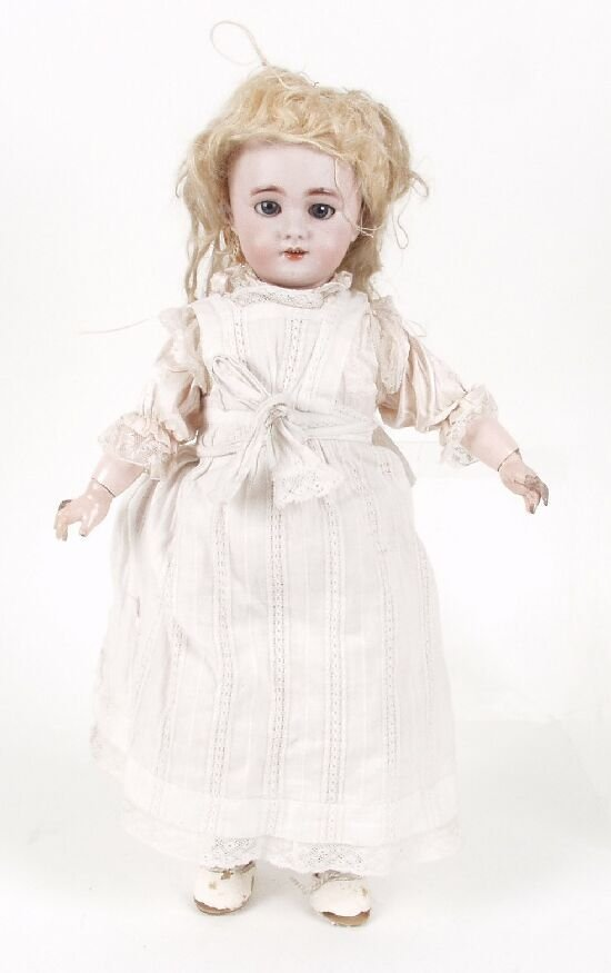 19: A D.E.P. bisque headed doll modelled as a