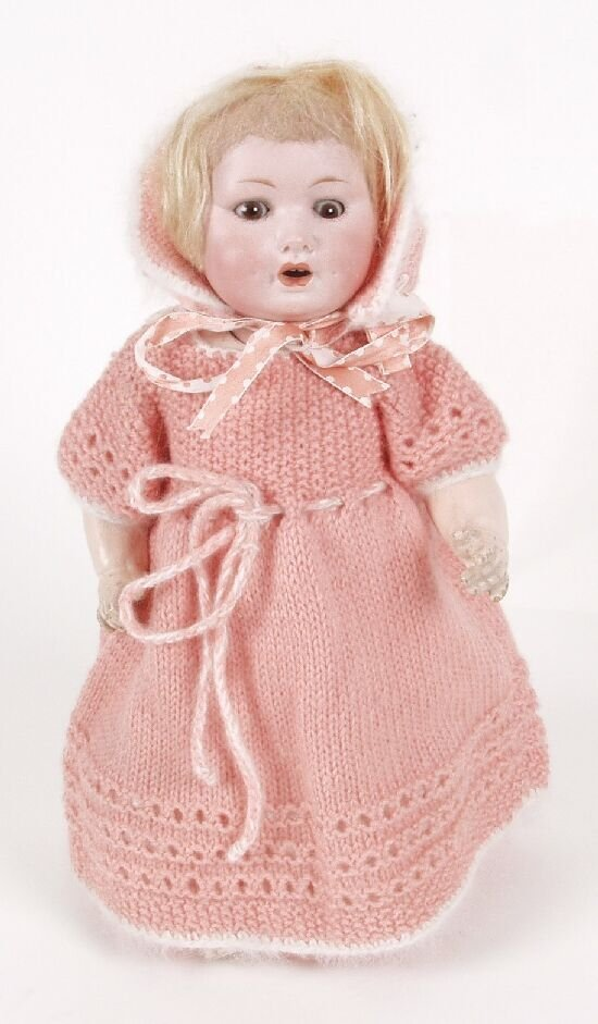 21: A German bisque headed doll, modelled as