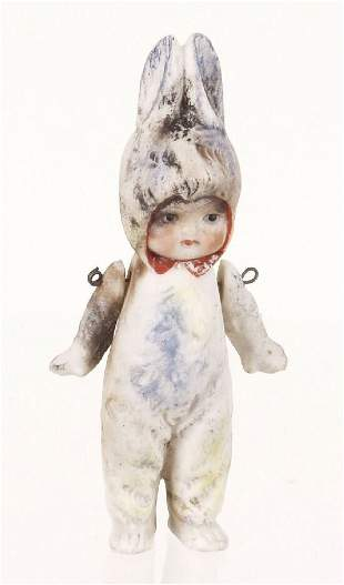 A German bisque miniature doll, modelled