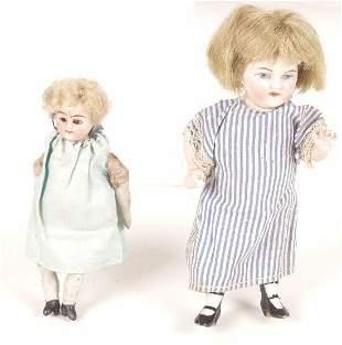 Two German bisque dolls house dolls.
